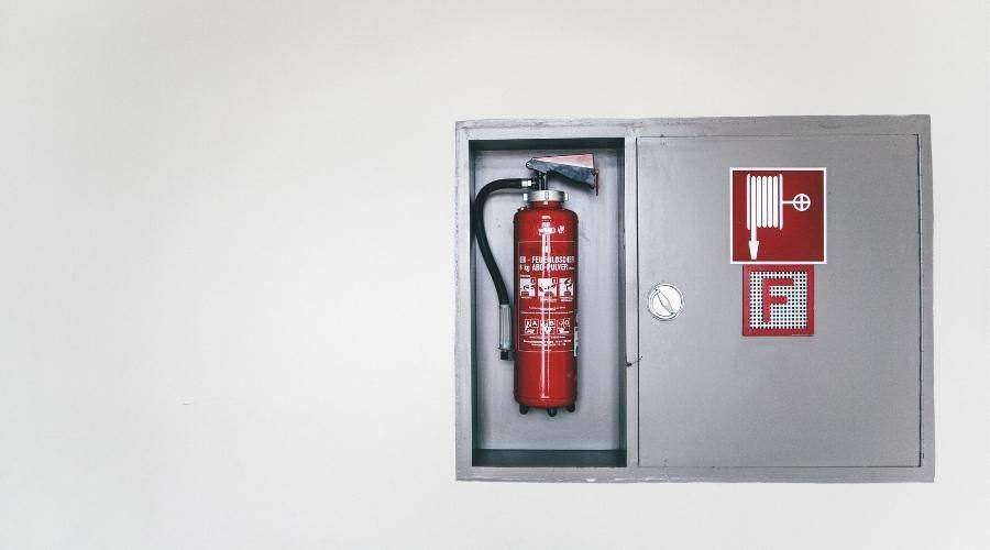 Fire extinguishers, which are also a part of a building's fire suppression system, should be regularly checked.