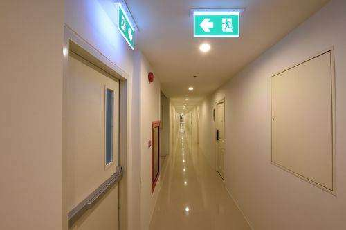 Emergency exit signs in hallways and corridors must have directional instructions.
