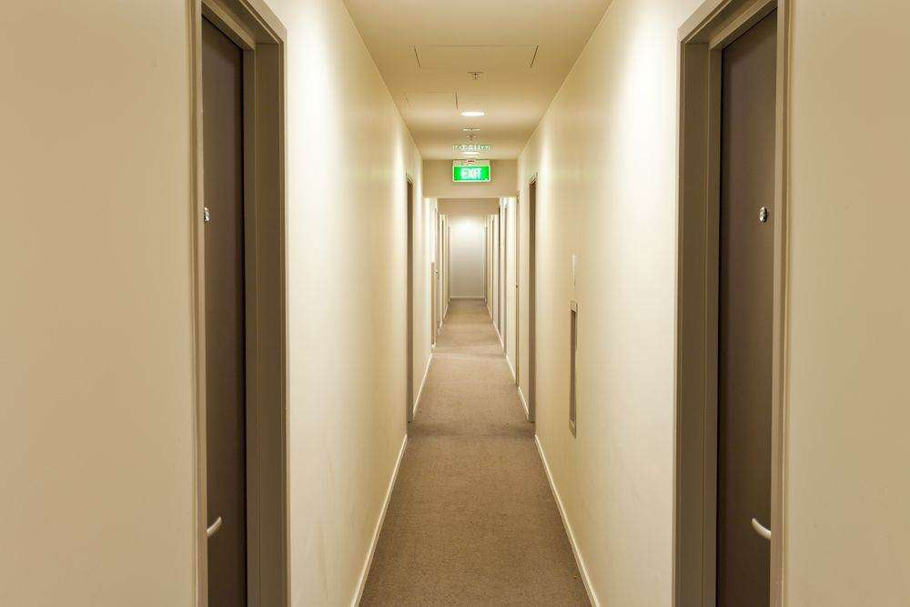 Hallways lit up with emergency exit signs